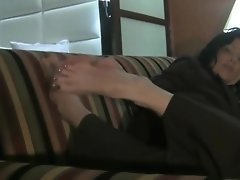 Attractive MILF Shows Her Feet On Couch