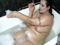 Mature Brunette Smokes In The Bath With Foam
