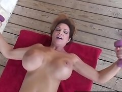 Muscular Mature Deauxma Works Her Nude Body In Front Of Home