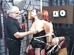 Two Leather-corseted Domination & Submission Captives Get Trussed And Roped Together By Older Dude