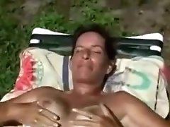 Before She Rubs Her Vagina MILF Tanning Within The Backyard