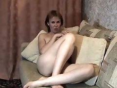 Blonde Mature MILF At Home Stripteasing And Fingering Her Pussy