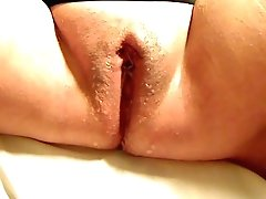 Close Up Of Mature Labia Finger-tickled And Squirting