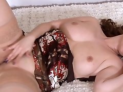 Sexy Mature Plays And Cums In Hold Up Stockings
